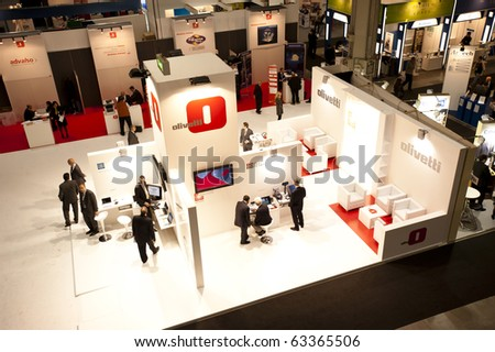 MILAN, ITALY - OCT. 20: Olivetti stand during SMAU, International Exhibition of Information and Communication Technology on October 20, 2010 in Milan, Italy. - stock photo