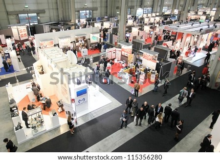 MILAN, ITALY - OCT. 19: People visit technologies exhibition area at SMAU, international fair of business intelligence and information technology October 19, 2011 in Milan, Italy. - stock photo