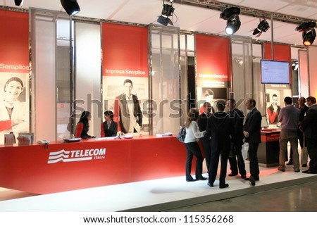 MILAN, ITALY - OCT. 19: People visit Telecom technologies exhibition area at SMAU, international fair of business intelligence and information technology October 19, 2011 in Milan, Italy. - stock photo