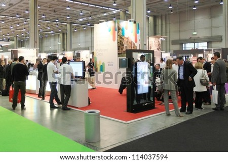 MILAN, ITALY - OCT. 19: People visiting technologies area during SMAU, international fair of business intelligence and information technology October 19, 2011 in Milan, Italy. - stock photo