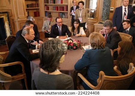 MILAN, ITALY - Oct 17, 2014: President Ukraine Poroshenko, German Chancellor Merkel, French President Hollande and Russian President Putin during a meeting on ASEM summit of European and Asian leaders - stock photo