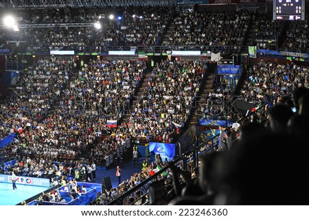 MILAN, ITALY-OCTOBER 10, 2014: arena crowd during the indoor female volleyball match Italy vs Russia during the Volleyball World Cup, in Milan. - stock photo