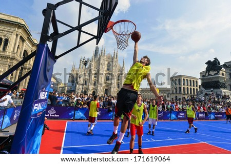 MILAN, ITALY - OCTOBER 06: Basketball demonstration match during an NBA event in Duomo square. Milan, October 06, 2012. - stock photo