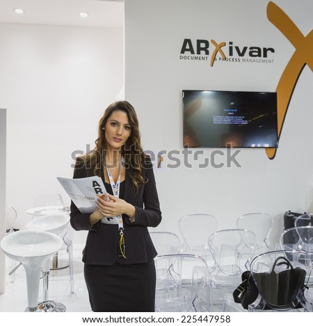 MILAN, ITALY - OCTOBER 22: Beautiful hostess at Smau, international exhibition of information communications technology on OCTOBER 22, 2014 in Milan. - stock photo