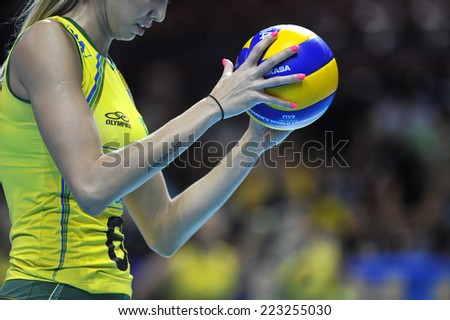 MILAN, ITALY-OCTOBER 10, 2014: Brazil player's hands close up holding the ball, during the indoor female volleyball match Brazil vs Dominican Republic of the Volleyball World Cup, in Milan. - stock photo