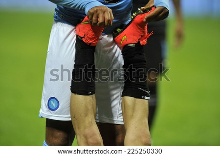 MILAN, ITALY-OCTOBER 19,2014: close up of a soccer player's legs suffering cramps during the soccer Italian serie A match FC Internazionale vs  Napoli, in Milan.