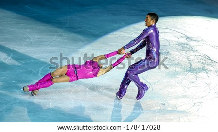 MILAN, ITALY-OCTOBER 11, 2008: Figure ice skaters couple competing on the Ice Christmas Gala at the Forum arena of Milan. - stock photo