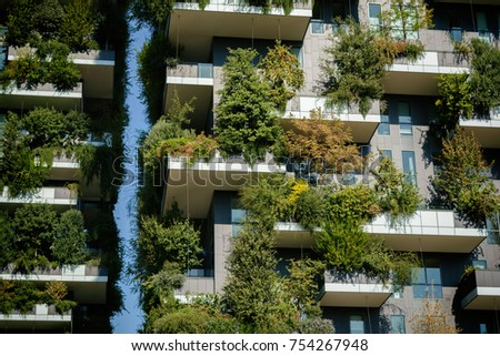 MILAN, ITALY - OCTOBER 9, 2017: fragment of Bosco Verticale, vertical forest apartment buildings in the business district of Porta Garibaldi, warm toned