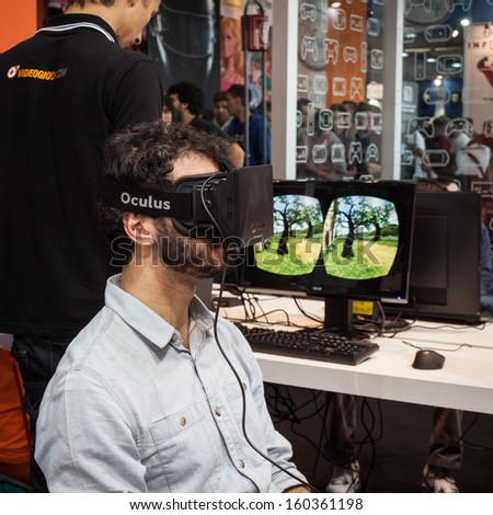 MILAN, ITALY - OCTOBER 26: Guy tries a virtual reality headset at Games Week 2013, event dedicated to video games and electronic entertainment on OCTOBER 26, 2013 in Milan. - stock photo