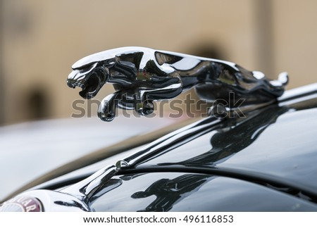 milan italy october 01 2016 hood ornament jaguar in the jump