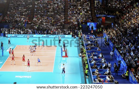 MILAN, ITALY-OCTOBER 10, 2014: indoor female volleyball match Italy vs Russia with crowded arena, during the Volleyball World Cup, in Milan. - stock photo