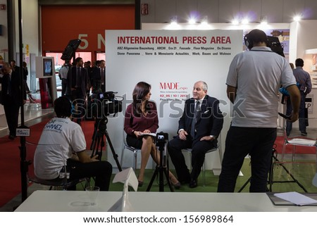 MILAN, ITALY - OCTOBER 3: Journalist interviews a businessman at Made expo, international architecture and building trade show on OCTOBER 3, 2013 in Milan.