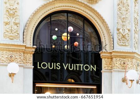 Milan, Italy - October 24, 2016: Louis Vuitton Sign of street shop window in Milan.
