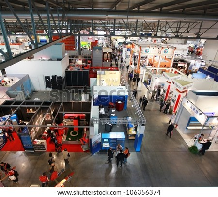 MILAN, ITALY - OCTOBER 08: Panoramic view of people visiting Sfortec 2010, international exhibition of machines, robots, automation and auxiliary technologies October 08, 2010 in Milan, Italy.