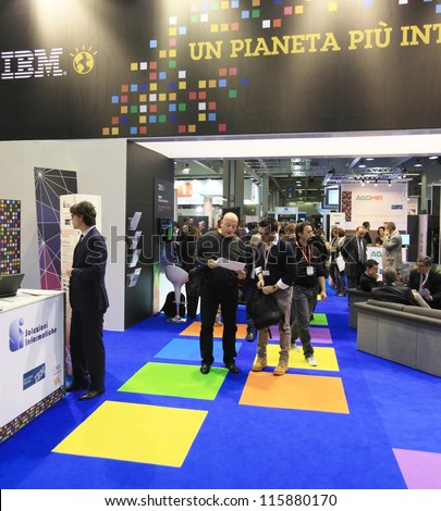 MILAN, ITALY - OCTOBER 17: People at IBM technologies products area at SMAU, international fair of business intelligence and information technology October 17, 2012 in Milan, Italy. - stock photo