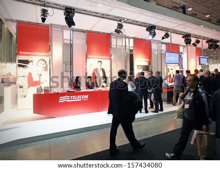 MILAN, ITALY - OCTOBER 19: People at Telecom technologies stand during SMAU, international fair of business intelligence and information technology October 19, 2011 in Milan, Italy.