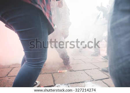 MILAN, ITALY - OCTOBER 10: People during Milan Zombie Walk, Italy on OCTOBER 10, 2015. Battle between soldier and zombie during Milan Zombie Walk