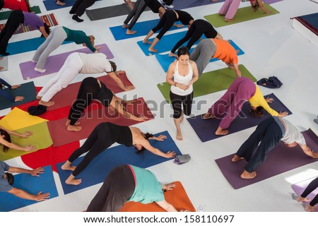 MILAN, ITALY - OCTOBER 11: People take a class at Yoga Festival 2013, event dedicated to yoga, meditation and healthy lifestyle on OCTOBER 11, 2013 in Milan.