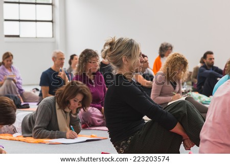 MILAN, ITALY - OCTOBER 10: People take a class at Yoga Festival, event dedicated to yoga, meditation and healthy lifestyle on OCTOBER 10, 2014 in Milan.