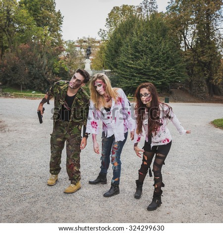MILAN, ITALY - OCTOBER 25: People take part in the Zombie Walk, social event in the city streets just before Halloween on OCTOBER 25, 2014 in Milan.