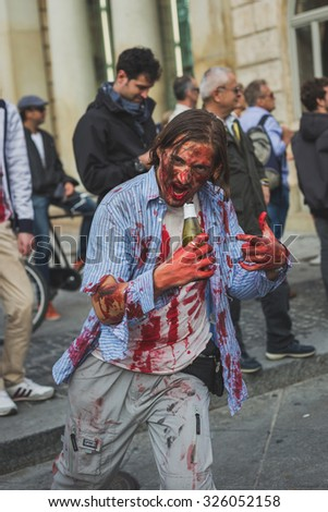 MILAN, ITALY - OCTOBER 10: People take part in the Zombie Walk, social event in the city streets just before Halloween on OCTOBER 10, 2015 in Milan.