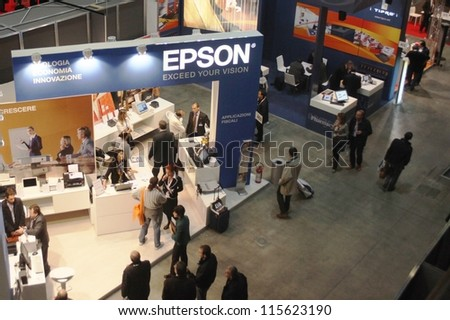 MILAN, ITALY - OCTOBER 21: People visit Epson technologies products exhibition area during SMAU, national fair of business intelligence and information technology October 21, 2009 in Milan, Italy. - stock photo