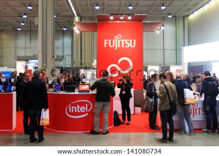 MILAN, ITALY - OCTOBER 17: People visit Fujitsu technology products exhibition area at SMAU, international fair of business intelligence and information technology October 17, 2012 in Milan, Italy. - stock photo