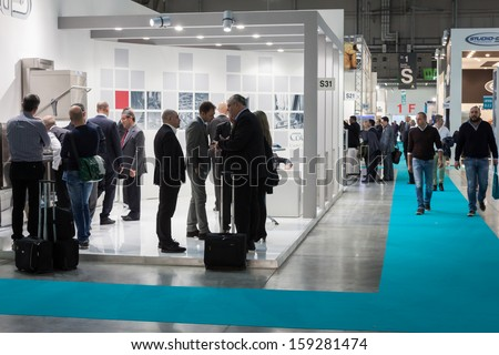 MILAN, ITALY - OCTOBER 18: People visit Host 2013, international exhibition of the hospitality industry on OCTOBER 18, 2013 in Milan. - stock photo