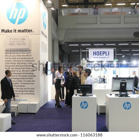 MILAN, ITALY - OCTOBER 17: People visit HP technology products exhibition area at SMAU, international fair of business intelligence and information technology October 17, 2012 in Milan, Italy. - stock photo