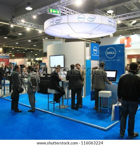 MILAN, ITALY - OCTOBER 17: People visit Intel technology products exhibition area at SMAU, international fair of business intelligence and information technology October 17, 2012 in Milan, Italy. - stock photo