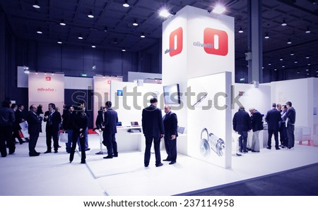 MILAN, ITALY - OCTOBER 20, 2010: People visit Olivetti products stands at SMAU, international fair of business intelligence and information technology in Milan, Italy. - stock photo