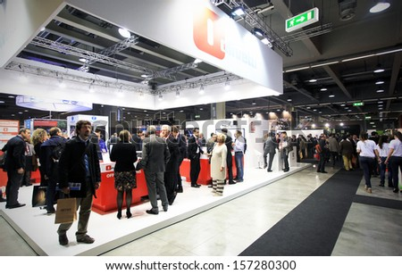 MILAN, ITALY - OCTOBER 17: People visit Olivetti technology products exhibition area at SMAU, international fair of business intelligence and information technology October 17, 2012 in Milan, Italy.  - stock photo