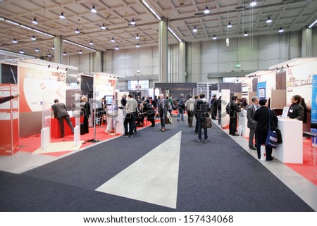 MILAN, ITALY - OCTOBER 19: People visit technologies exhibition area during SMAU, international fair of business intelligence and information technology October 19, 2011 in Milan, Italy.  - stock photo