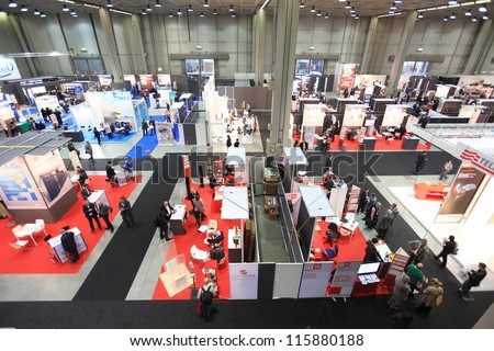 MILAN, ITALY - OCTOBER 17: People visit technologies products area at SMAU, international fair of business intelligence and information technology October 17, 2012 in Milan, Italy. - stock photo
