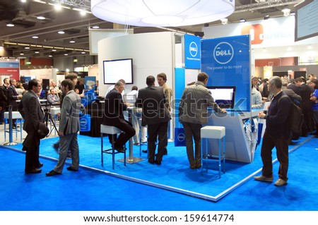 MILAN, ITALY - OCTOBER 17: People visit technology products exhibition area at SMAU, international fair of business intelligence and information technology October 17, 2012 in Milan, Italy.  - stock photo