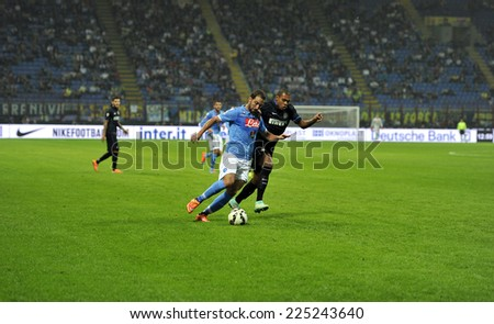 MILAN, ITALY-OCTOBER 19,2014: players Juan Jesus and Gonzalo Higuain in action during the Italian serie A night soccer match FC Internazionale vs  Napoli at the san siro stadium, in Milan. - stock photo