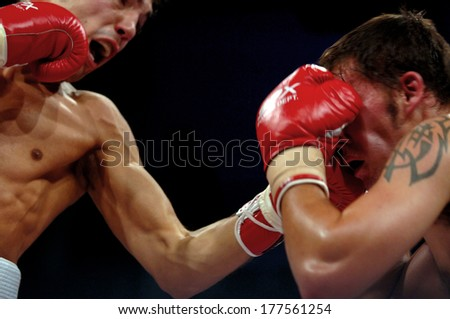 MILAN, ITALY-OCTOBER 17, 2006: professional boxers fighting during a professional boxing match. - stock photo
