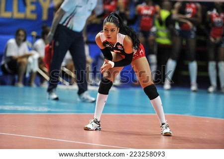 MILAN, ITALY-OCTOBER 10, 2014: Republic Dominican player Adenizia Silva in action during the indoor female volleyball match Brazil vs Dominican Republic of the Volleyball World Cup, in Milan.