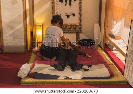 MILAN, ITALY - OCTOBER 10: Shiatsu massage at Yoga Festival, event dedicated to yoga, meditation and healthy lifestyle on OCTOBER 10, 2014 in Milan.
