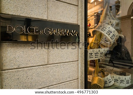 Milan, Italy - October 9, 2016: Shop window and entrance of a Dolce & Gabbana shop in Milan - Montenapoleone street, Italy. Few days after Milan Fashion Week. Fall Winter 2017 Collection.