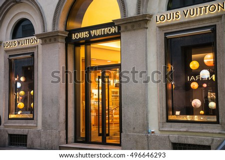 Milan, Italy - October 8, 2016: Shop window and entrance of a Louis Vuitton shop in Milan - Montenapoleone street, Italy. Few days after Milan Fashion Week. Fall Winter 2017 Collection.