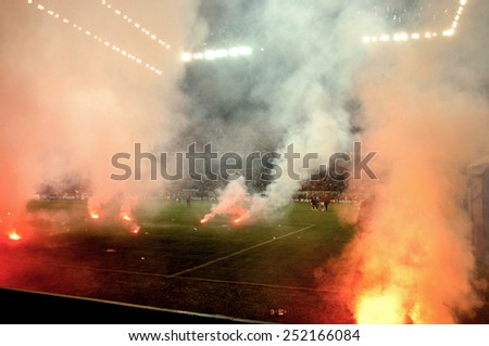 MILAN, ITALY-OCTOBER 11, 2005: smoke caused by firecrackers thrown by soccer fans on the san siro soccer pitch, during the derby match AC Milan vs FC Internazionale,in Milan. - stock photo