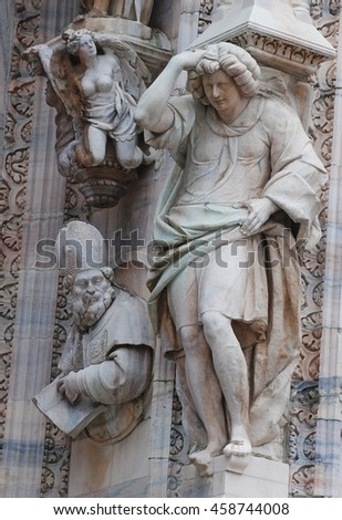 MILAN, ITALY - OCTOBER 14, 2014. Statues, depicting human figures, adorning the Duomo cathedral in Milan.