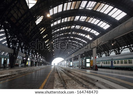 MILAN, ITALY - OCTOBER 22: the Central Train Station interior in a wide-angle view on October 22, 2013 in Milan, Italy. Milano Centrale is the Italian second-largest station. - stock photo