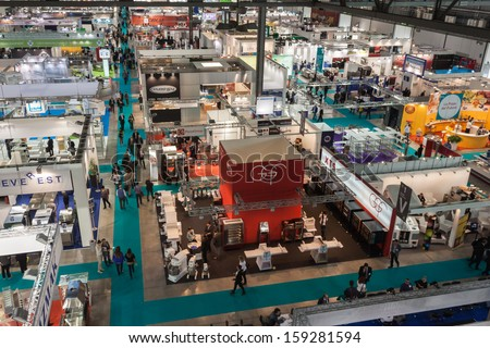 MILAN, ITALY - OCTOBER 18: Top view of booths and people at Host 2013, international exhibition of the hospitality industry on OCTOBER 18, 2013 in Milan. - stock photo