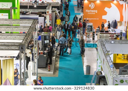 MILAN, ITALY - OCTOBER 16: Top view of booths and people at Viscom, international trade fair and conference on visual communication and event services on OCTOBER 16, 2015 in Milan.