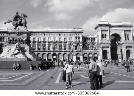 MILAN, ITALY - OCTOBER 7, 2010: Tourists visit Piazza Duomo in Milan, Italy. As of 2006, Milan was the 42nd most visited city worldwide, with 1.9 million annual international visitors. - stock photo