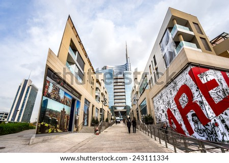 MILAN, ITALY - OCTOBER 15,2014:  View of the new  modern glass building of Unicredit and modern building in Porta Nuova Area. - stock photo