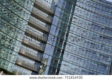 MILAN, ITALY - OCTOBER 9, 2017: View of the Unicredit tower and Piazza Gae Aulenti in the business district of Porta Garibaldi, fragment of glass and steel modern building facade