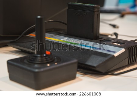 MILAN, ITALY - OCTOBER 24: Vintage Atari console at Games Week 2014, event dedicated to video games and electronic entertainment on OCTOBER 24, 2014 in Milan. - stock photo